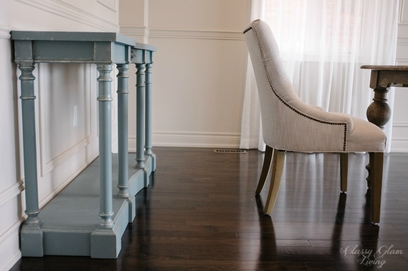 Space between chair and console table.