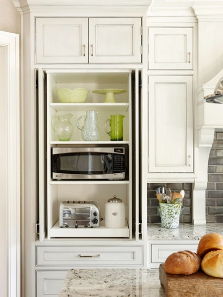 hidden inside a pantry; image via  Better Homes & Gardens