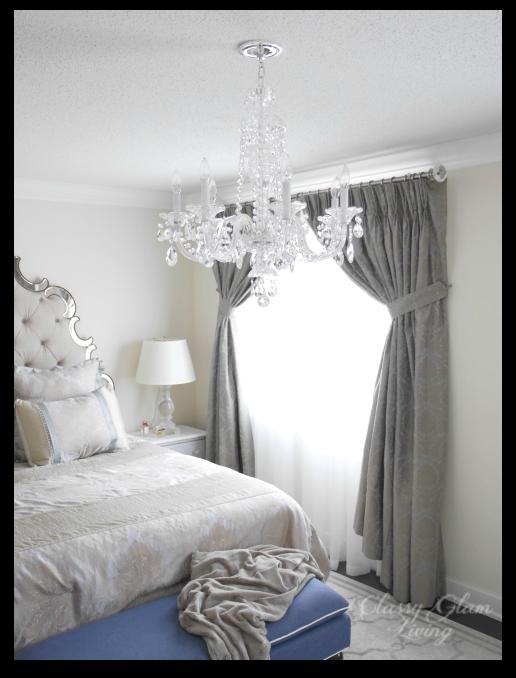 Master bedroom chandelier | Schonbek 2995 Tufted headboard mirror trim | Classy Glam Living