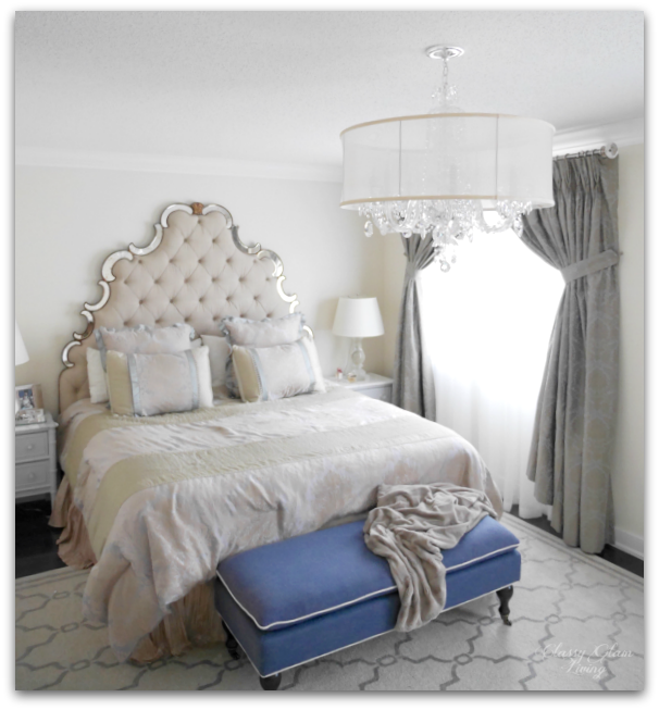 Master bedroom chandelier | Schonbek 2995 with silk shade.  Turfted headboard with mirror trim | Classy Glam Living