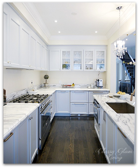 Giving a Builder's Kitchen a Personal Touch with Cabinet Hardware | New House Kitchen Update Glass Knobs & Bronze Pulls Before Photo | Classy Glam Living 3