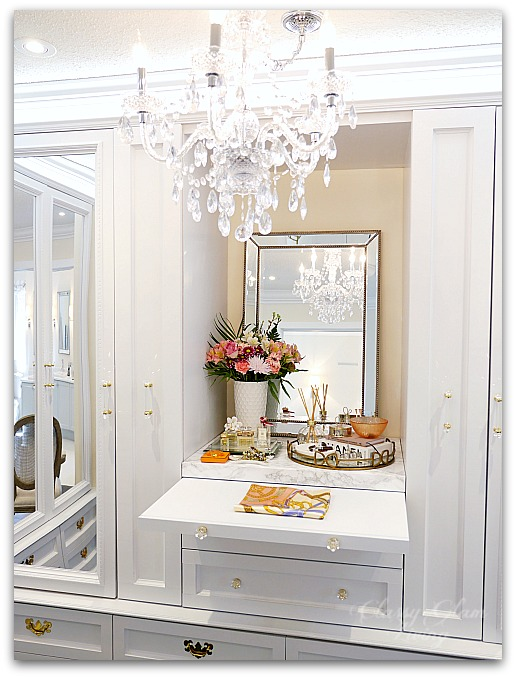 DIY Custom Closet Dressing Room | Crystal chandelier, pull-out folding table, glam DIY walk-in closet | Vanity marble counter top styling Hermes perfume jewelry tray | Classy Glam Living