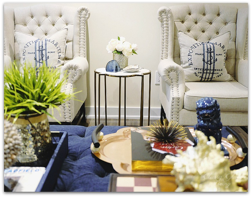 Blue and white decor in family room | navy blue ottoman | Classy Glam Living