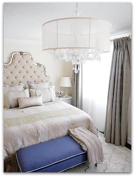 Navy blue bench at foot of bed | crystal chandelier master bedroom | Classy Glam Living