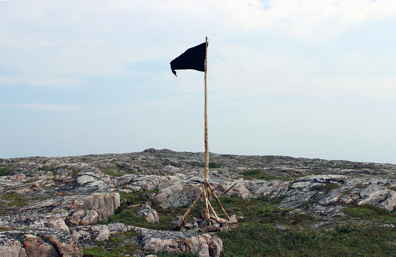 """blackflag (fogo island)"" wood, nails, rope, burlap, paint. Impermanent public sculpture,  2013"