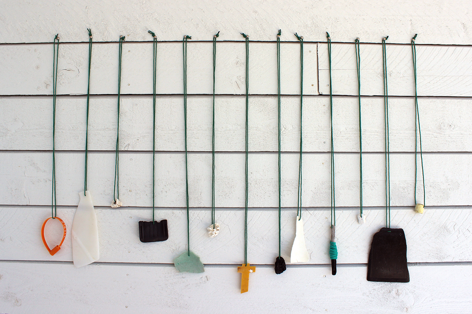 """""""offerings"""" beach debris and flotsam attached to twine and left for tourists, Joe Batt's Arm, NL 2013"""