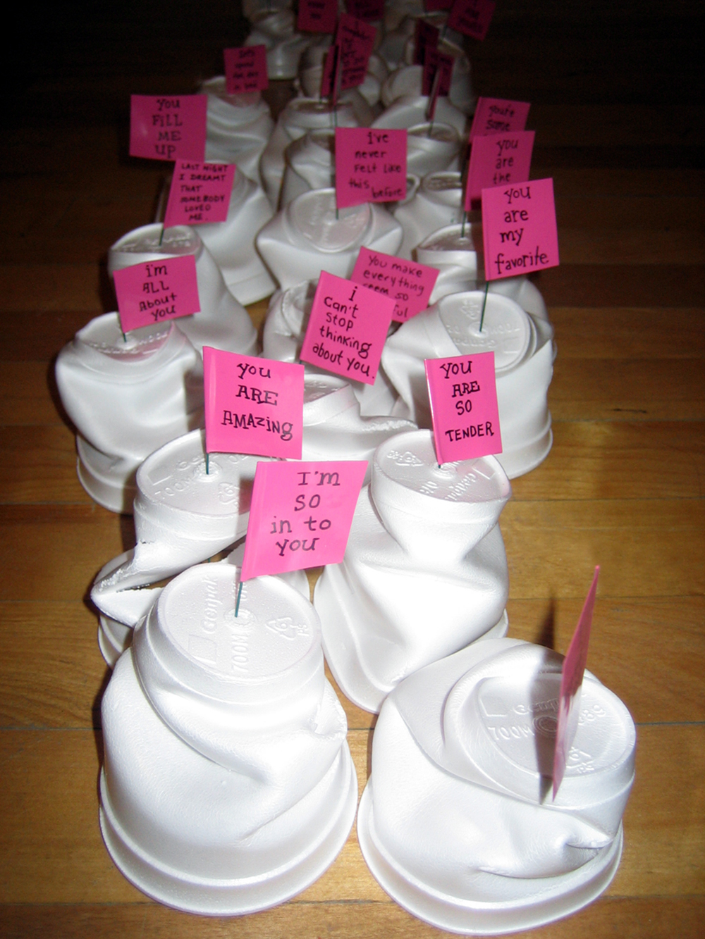 """tiny mounds of love"" vinyl, ink, wire and styrofroam cups, 2004"