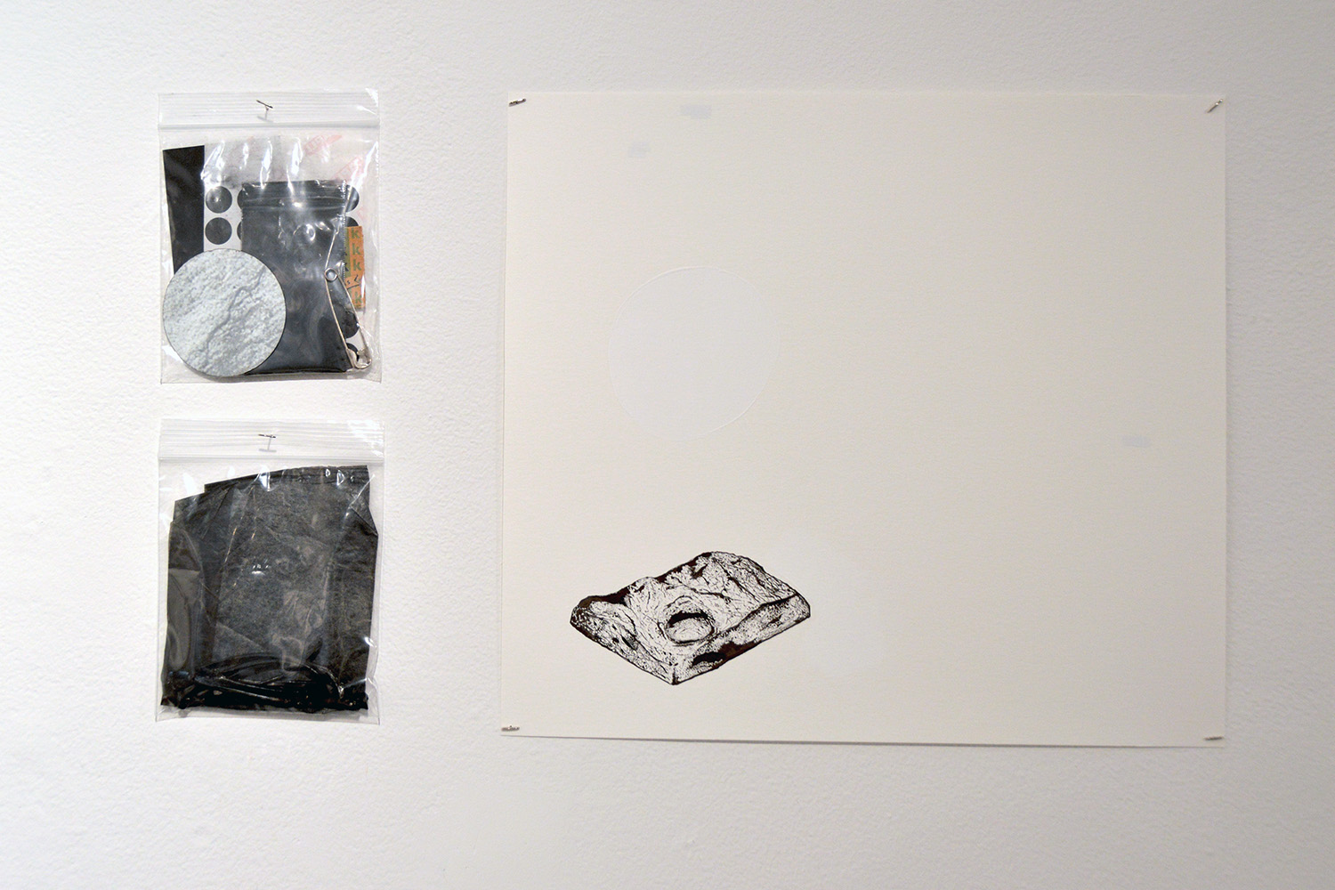 """""""the collective"""" (installation detail) ink on paper, with found object and black chalk in plastic bags, 2016"""