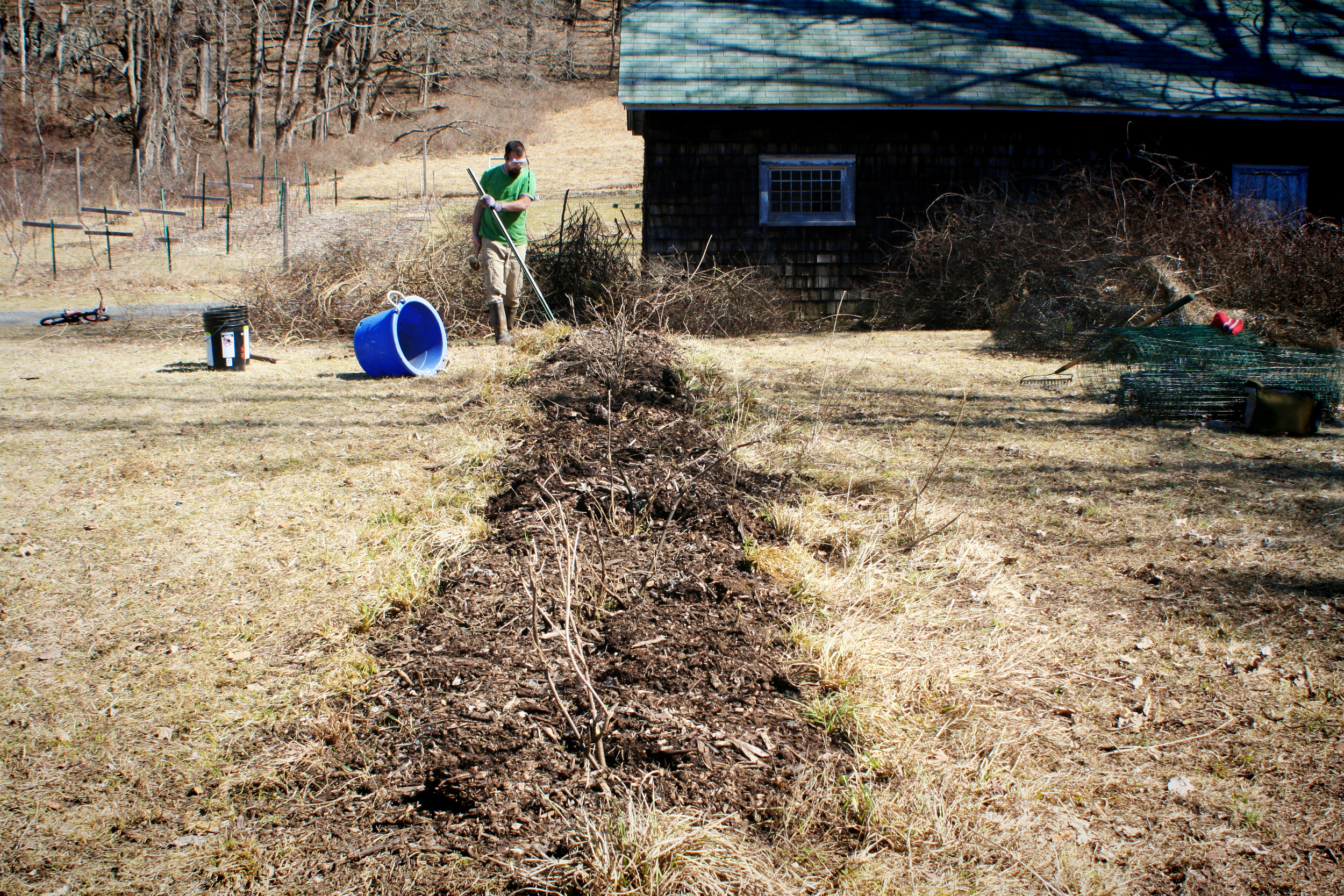 All mulched up. Posts getting hammered into the (painfully) rock-filled ground.