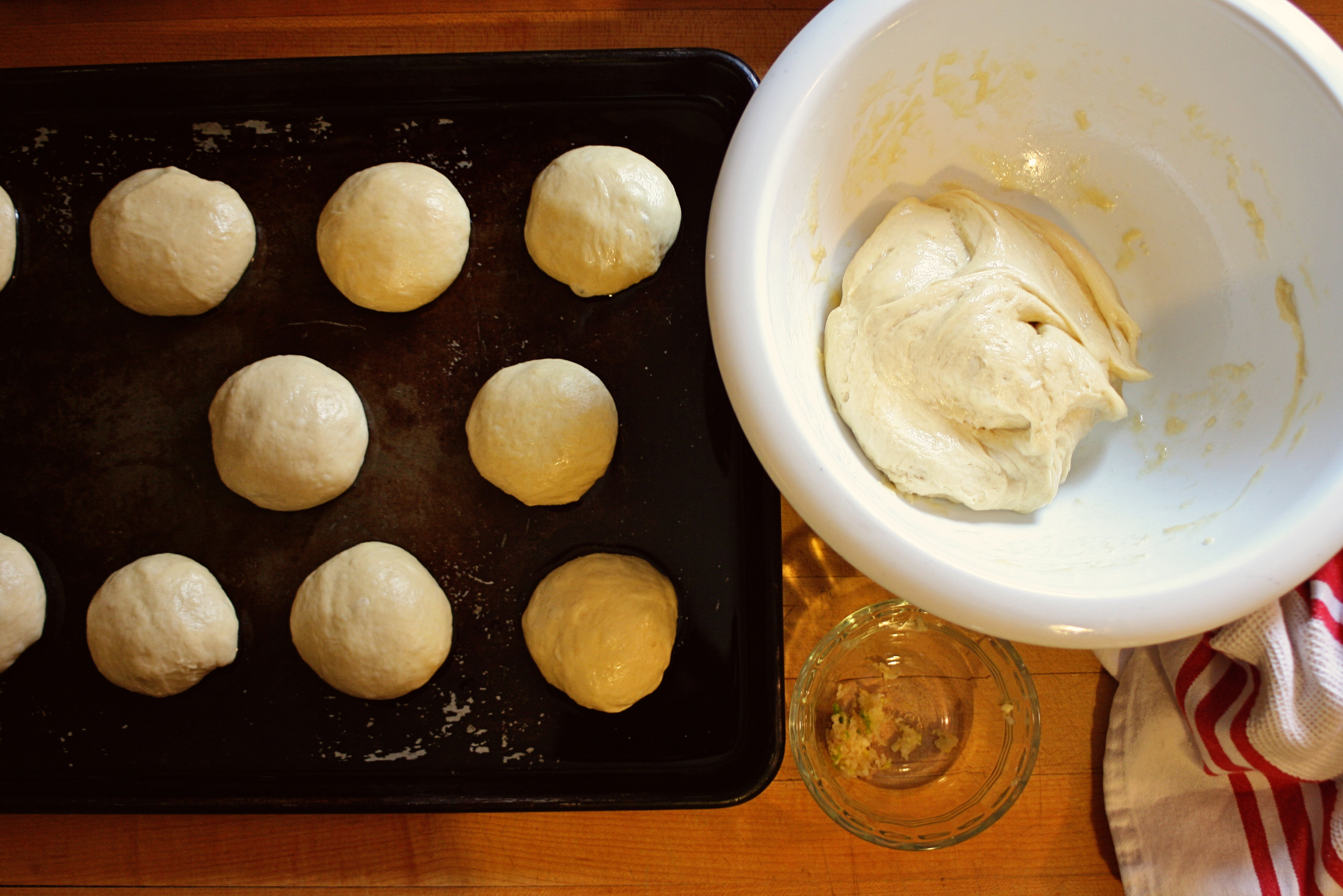 Forming the small dough balls and adding the garlic.