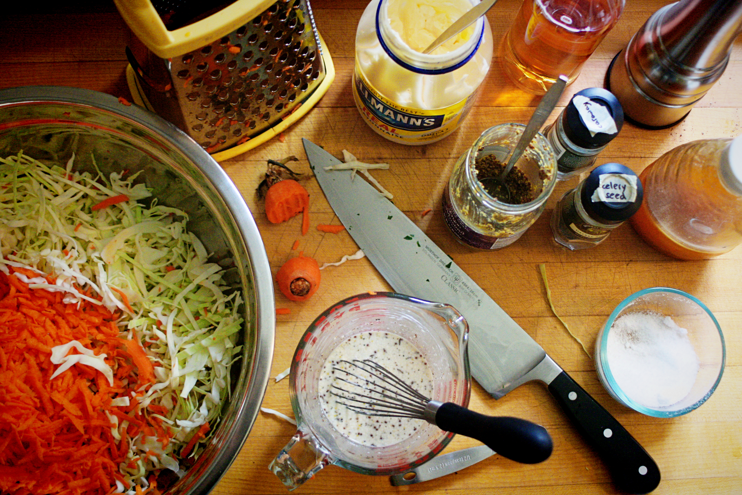 I thinly slice the cabbage (  a whole small or half a large) andshred 2 carrots on a box grater. The dressing is: 1 Tbs honey, ¼ cup   cider vinegar, 1Tbs whole grain mustard, ½ tsp celery seed, 1 tsp caraway seed, 2 Tbs mayo, and salt & pepper to taste; whisked until smooth.