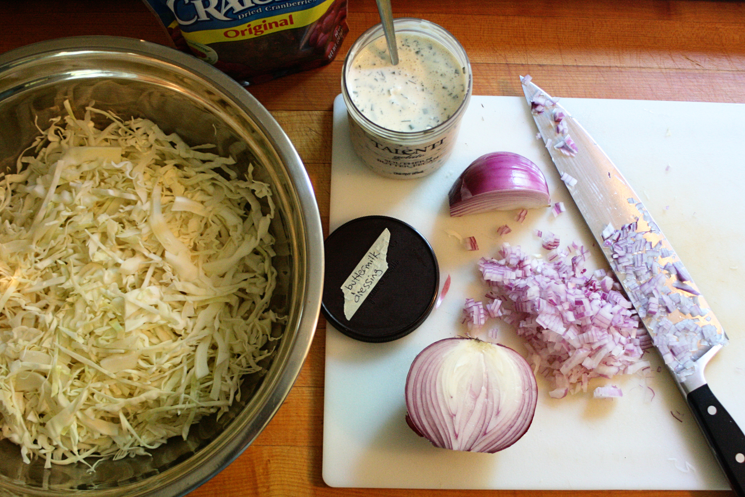 I thinly slice one small or half a large head of cabbage, chop a half of a red onion (somewhat finely), and toss in about a cup of dried cranberries.