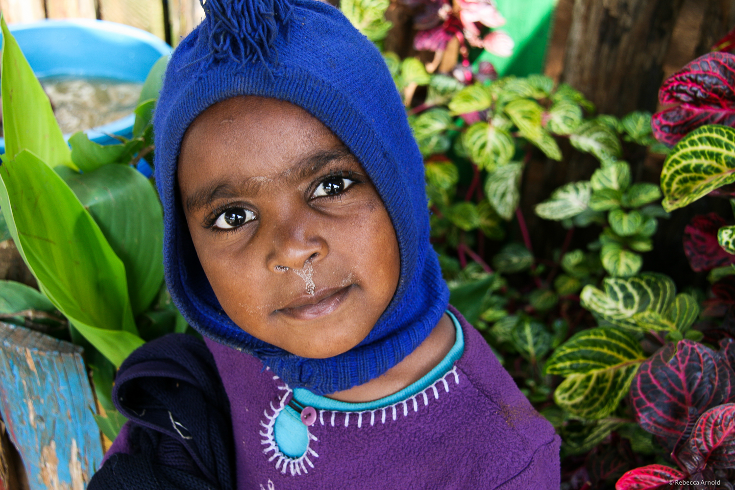 The closest I saw her come to a smile in two weeks. Orphan, Limuru, Kenya