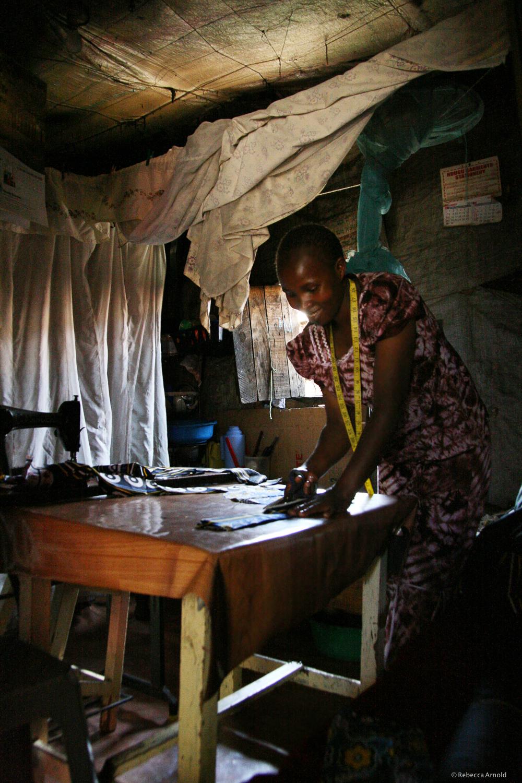 Sewing handbags as a small business. Kibera Slum, Nairobi, Kenya.
