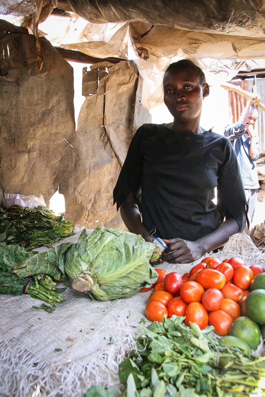 A micro loan allowed her to start this produce stand.Kibera Slum, Nairobi, Kenya