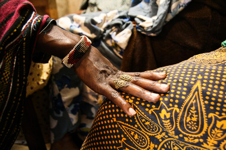 Women sitting with their loan officer at a Turning Point Trust, paying and receiving micro loans. Kibera Slum, Nairobi, Kenya