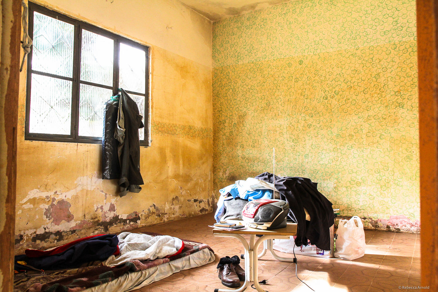 His bedroom, four months after the flood. Note the waterline on the walls.