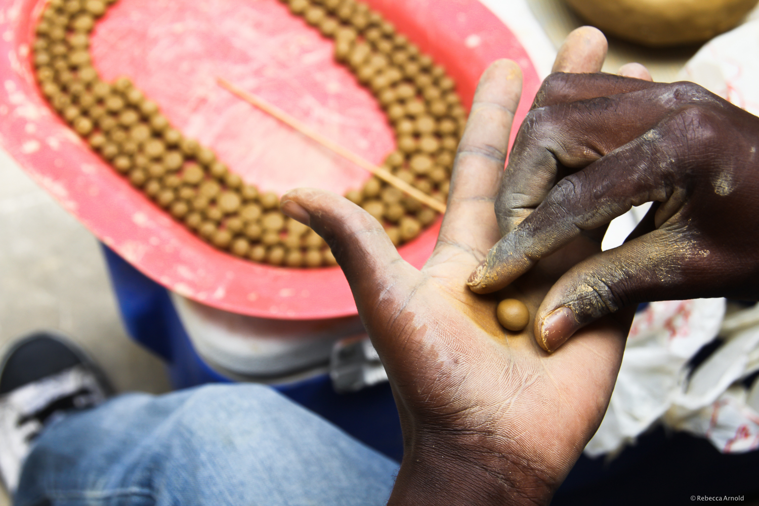 Port Au Prince, Haiti.  Apparent Project  employs hundreds of Haitians to make jewelry. This clay used for beads is  eaten  by Haiti's poorest, for presumed minerals and to fill their bellies.