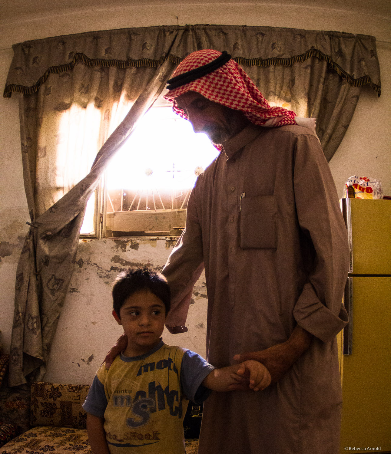 Father and Down's Syndrome son.Syrian refugees in make-shift home. Near Zaqra, Jordan