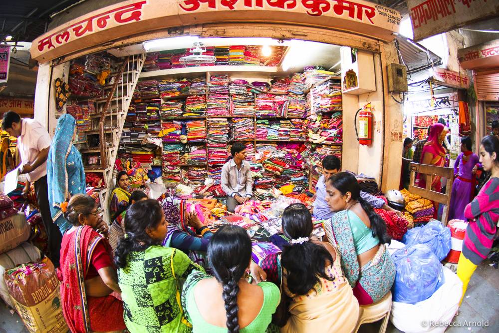 Deep inside Bapu Bazar women are shown choices of colorful sari's.