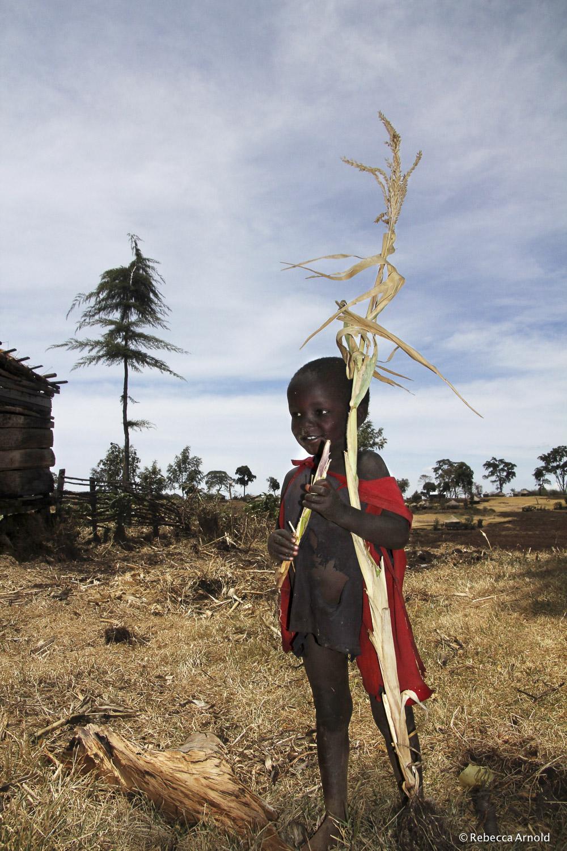 "Sugarcane Treat, Uganda 2011   16"" x 24"" | 24"" x 36"" | Custom Sizes  Archival Pigment Prints  Edition: 150"