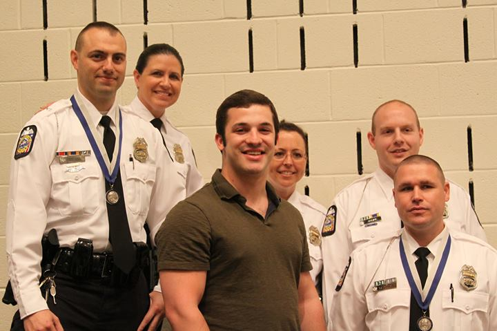 Mark with the Officers that saved his life, at an event recognizing their outstanding efforts