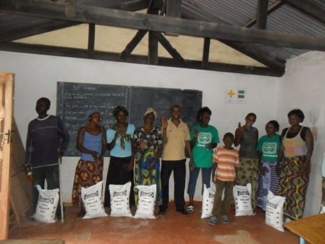 Christian Aid Ministries giving food to patients in St. Anthony community on Friday 10th February 2012
