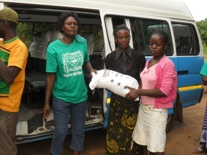 Matilda giving food to Sara in St. Anthony community on February 10th 2012