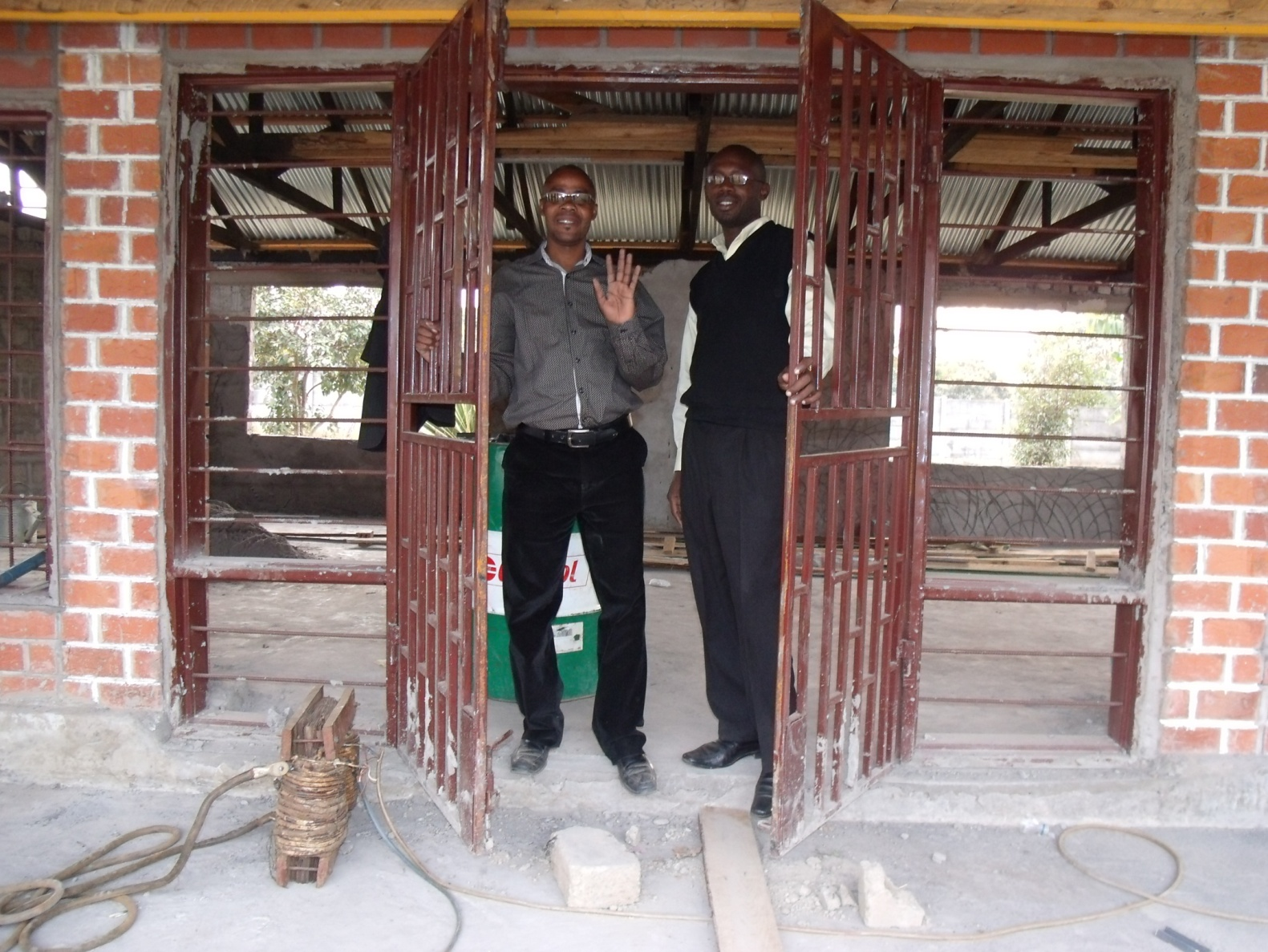 (L-R) Stanley Mulenga CAM director with one of the inspectors from the ministry of health in Kitwe
