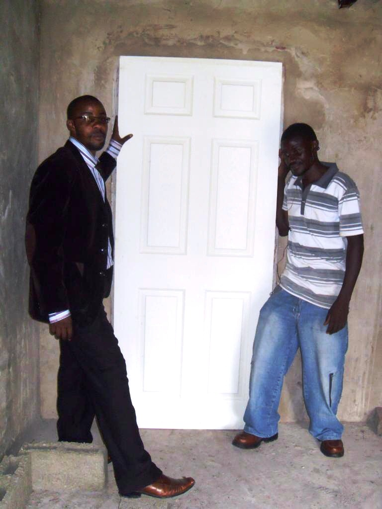 (L – R) Stanley and Cliff sizing the door in its frame and padlocks for the grill doors to ensure proper security