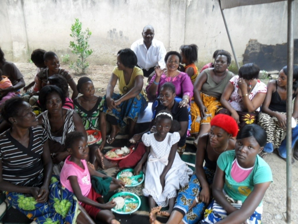 Copperbelt MMD chair person Mrs. Mataka (seated in pink) identifying herself with our TB/HIV/AIDS clients
