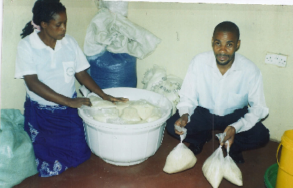 Bernadette (Stan's wife) and Stanley parking soya flour for the patients at the Chest Clinic