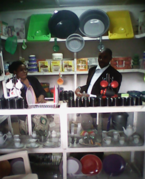 Mr. Stanley Mulenga and his wife Bernadette at the shop selling the kitchen ware merchandise