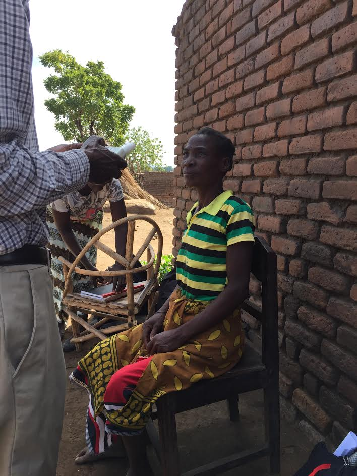 Graham Flitz  (GHE '16) together with local researchers were giving instructions to grandmother about the program and spirometry testing in Malawi.