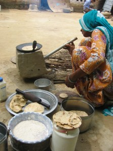 Local woman preparing chapatis using a traditional mud chullah in Haryana, India.  Jenny Eav's (GHE '14) research project involved field testing a new platform for monitoring stove use.