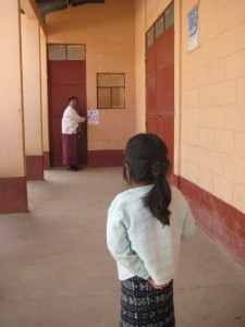 6-year-old Guatemalan girl taking a seeing eye exam before her neurobehavioral interview – as part of  Linda Dix-Cooper 's (GHE '10) fieldwork in Guatemala.