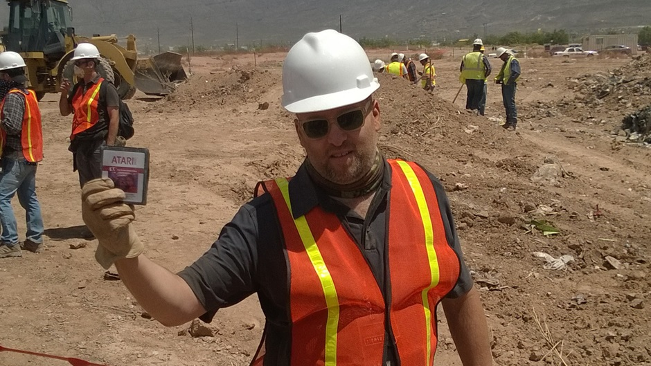 Filmmaker Zak Penn holds up one of the found E.T. Cartridges in Alamagordo, New Mexico. (Courtesy Xbox.com)