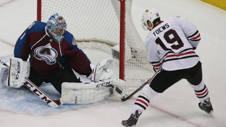 Blackhawks captain Jonathan Toews takes a shot on Avalanche goaltender Semyon Varlamov on March 12, 2014