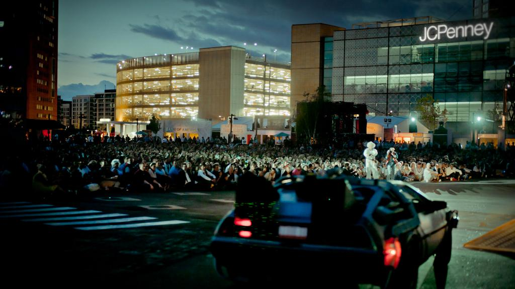 Doc and Marty stand in front of the London crowd as the DeLorean carrying Einstein zooms by in time with the film. (Courtesy Secret Cinema)