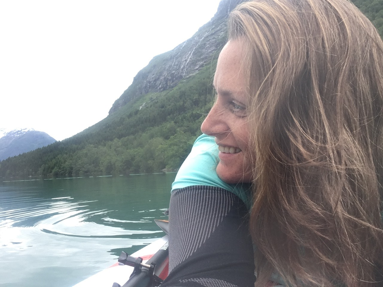 Camilla Stand Up Paddling on beautiful Lovatnet Lake in Norway