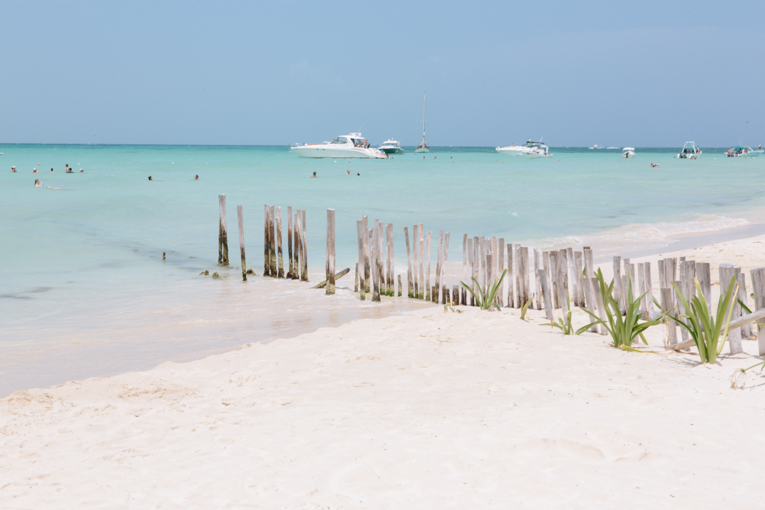 Crystal clear waters and powder-white sand, enjoyed by tourists and locals together.