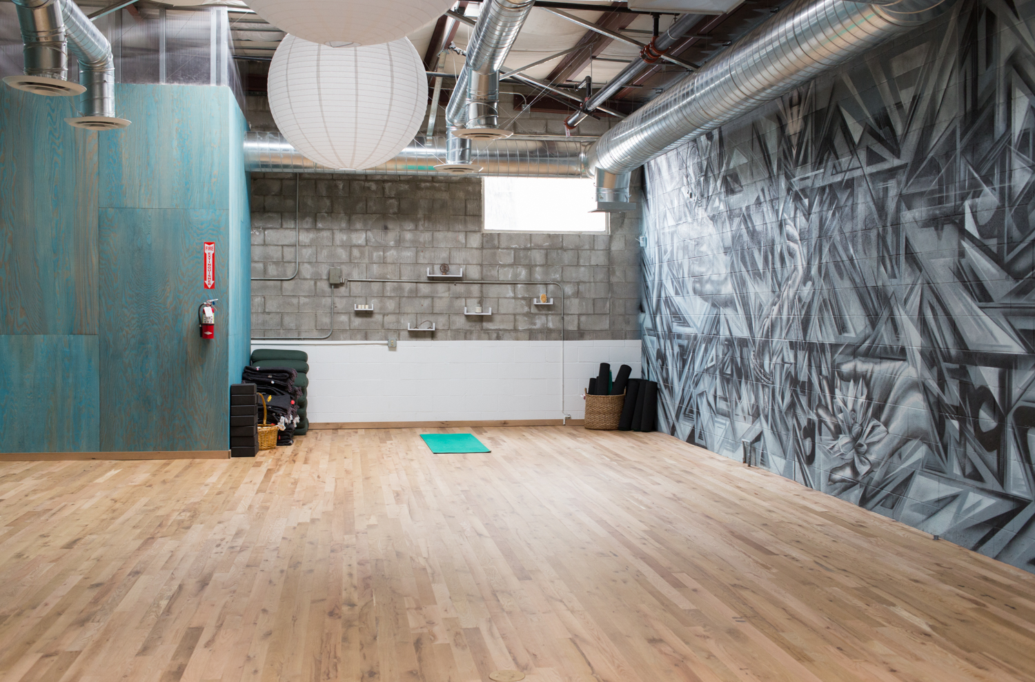 Yoga studio with mural by LA artist Angelina Christina.
