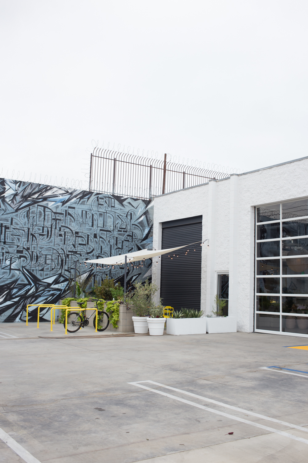 Ample parking in the lot with another mural.