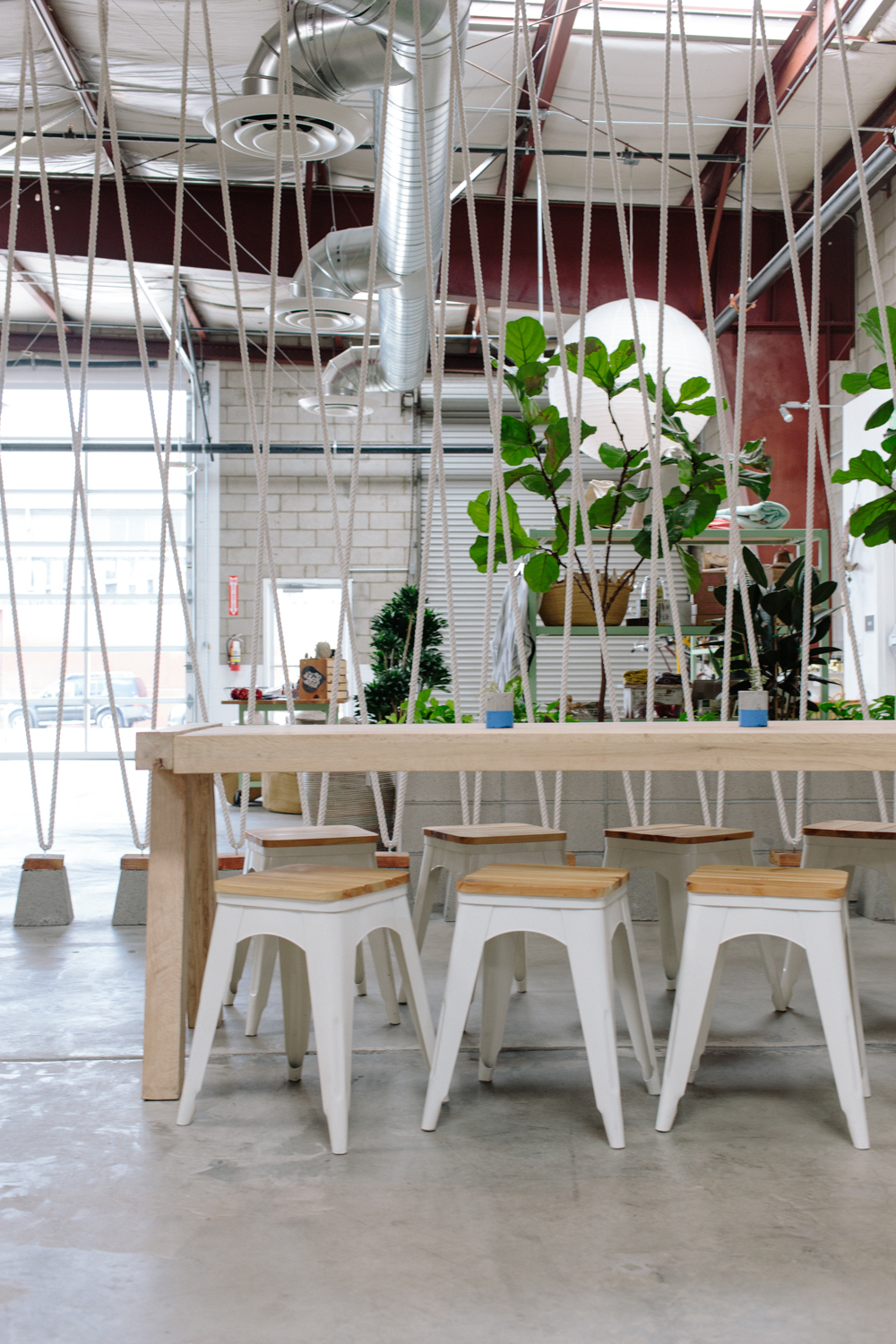 """Cool rope detailing """"separates"""" the store space from the communal table."""