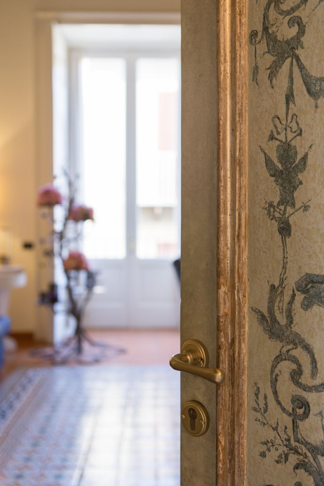 Doors at Maison Tofani retain the artwork of the 18th century