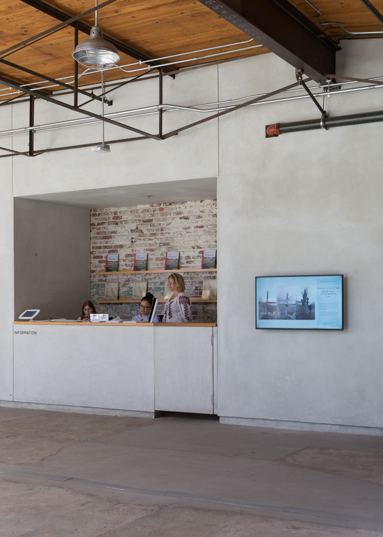 Beautiful concrete craftsmanship frames the information desk