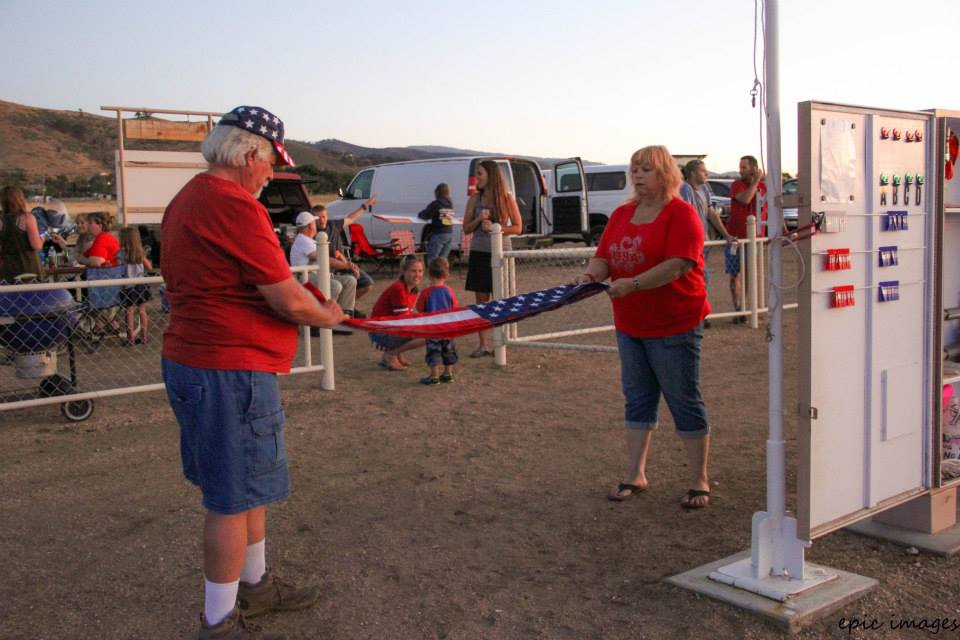 Event organizers Bob & Debbie Golk fold the flag at sunset. Not shown are organizers Wayne Sewell & Ron Burgess. Thank you for your effort organizing a great event!