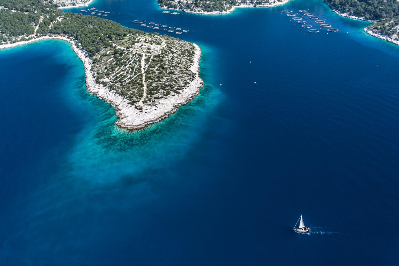 Cliffs and sailing boat.jpg