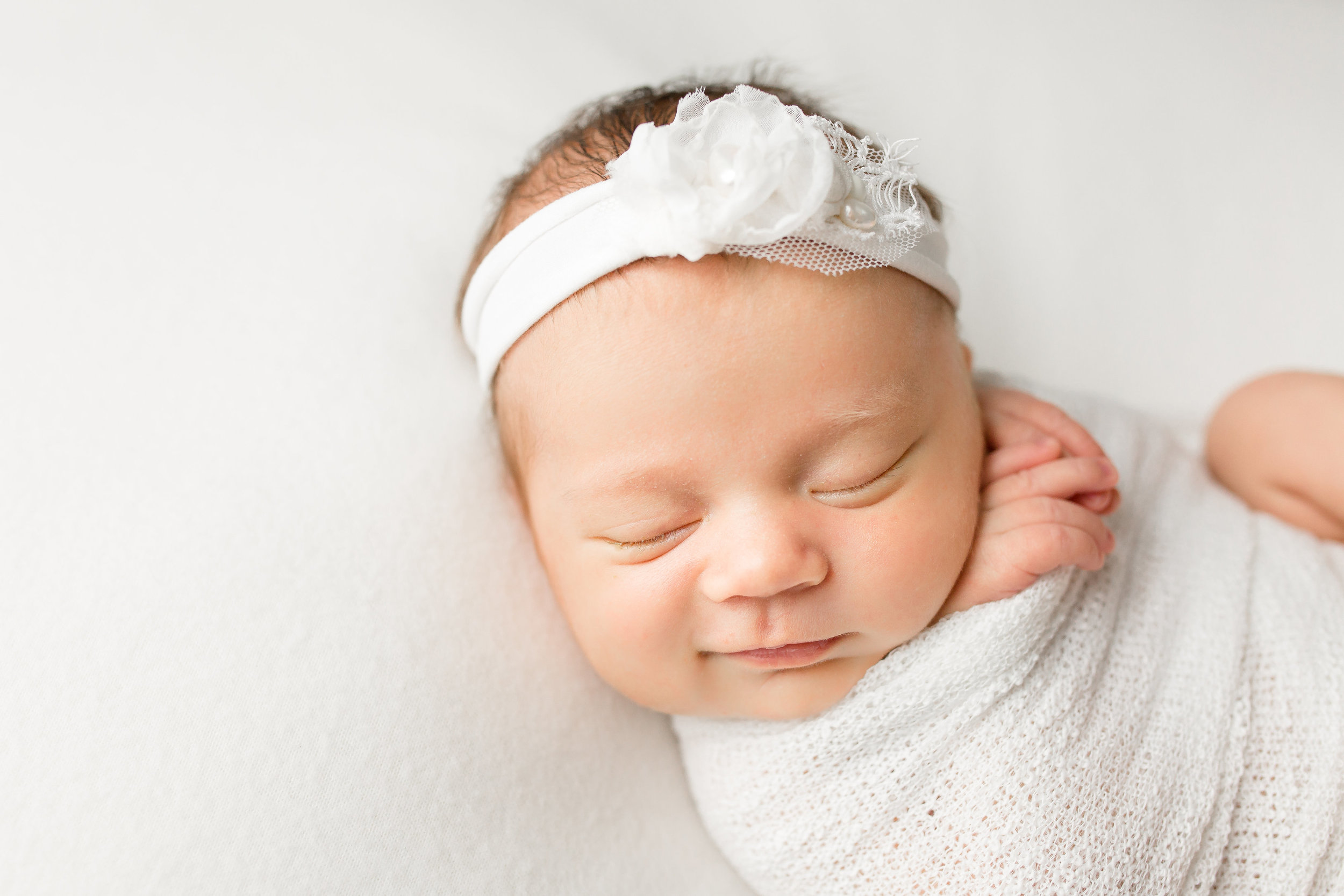Newborn-smiles-during-photo-session-sarah-cropper-photography