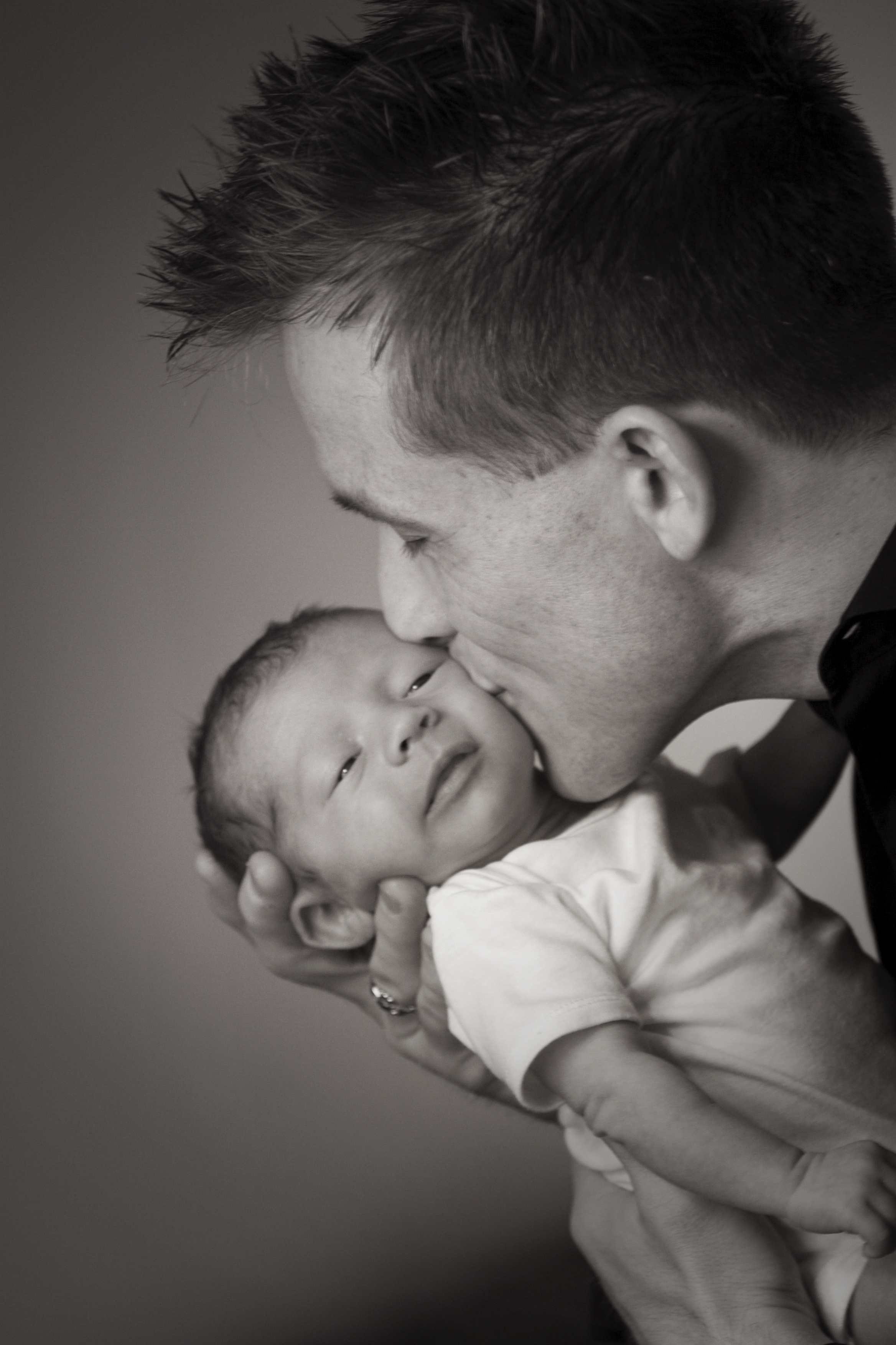 """The images that you captured of our newborn son are just priceless! I have them displayed on our living room wall and enjoy looking at them every single day!""  Mike and Lexi Winnen"